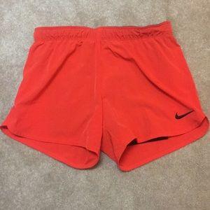 Dark coral Nike Dri-Fit shorts